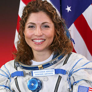 Profile of Anousheh Ansari in her space suit.